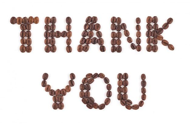 Grãos de café torrados de alta resolução em letras Foto Premium