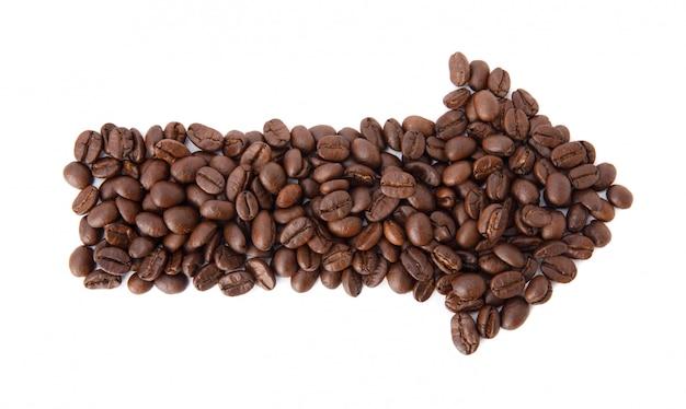 Grãos de café torrados em forma de seta