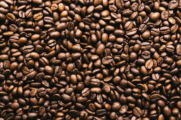 Grãos de café. vista do topo. conceito de café. Foto gratuita