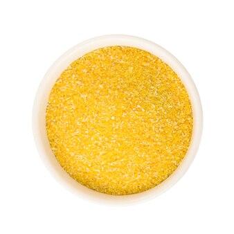 Grãos de milho ou milho em placa de cerâmica redonda ingrediente alimentar cru isolado no fundo branco