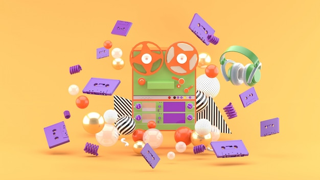 Gravador entre as fitas e fones de ouvido na laranja. renderização em 3d.