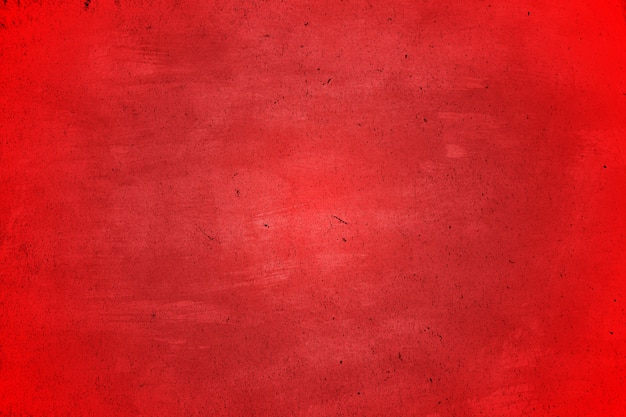 Grounge vermelho e abstrato sujo de textura com arranhões e rachaduras com copyspace