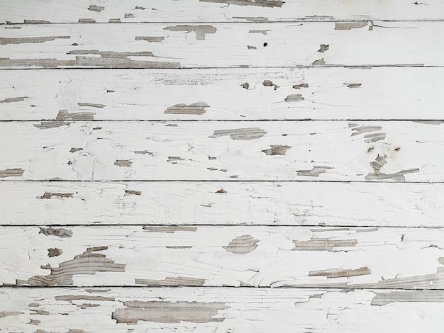 Grunge descascando textura de madeira de tinta branca