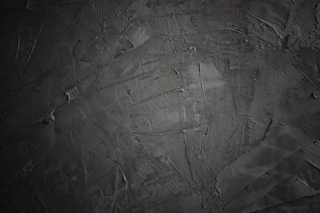 Grunge escuro e preto e textura de cimento ou concreate