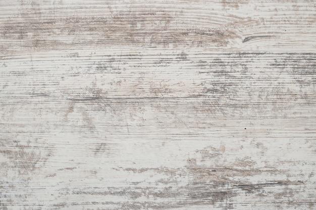 Grunge pintura descascada em um assoalho de madeira velho.