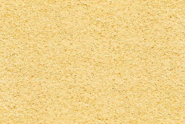 Grunge superfície amarela. fundo áspero texturizado.