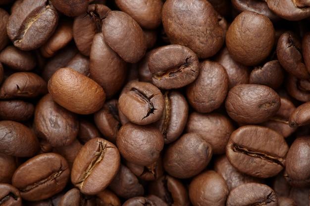 Grupo de grãos de café marrons, macro, close-up