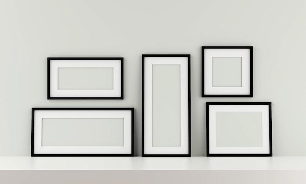 Grupo de moldura para retrato preta na parede. 3d rendem.