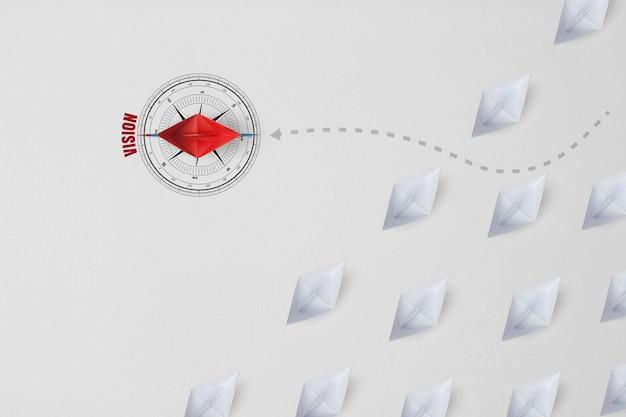 Grupo de navio de papel em uma direção e com um indivíduo apontando de forma diferente como um ícone de negócios para soluções inovadoras.
