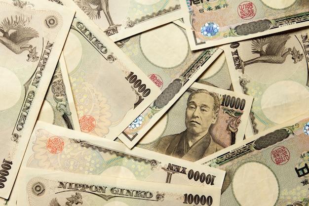Grupo de nota de banco japonês 10000 ienes fundo