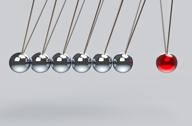 Grupo de pêndulo bateu uma bola vermelha. todo o efeito da força a um conceito