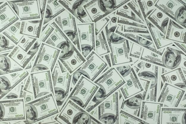 Grupo de pilha de dinheiro de 100 notas de dólares americanos textura vista superior fundo