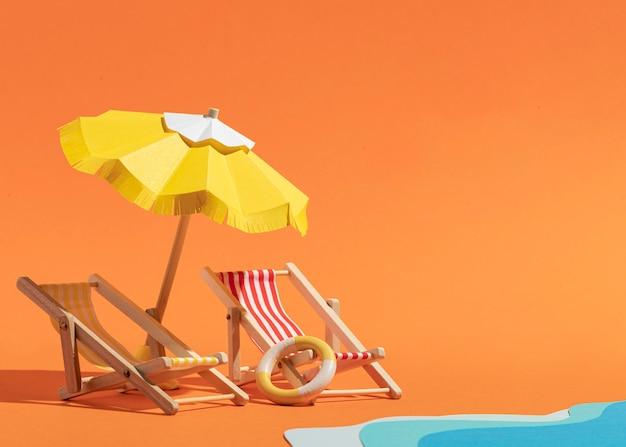 Guarda-chuva de verão com espreguiçadeiras