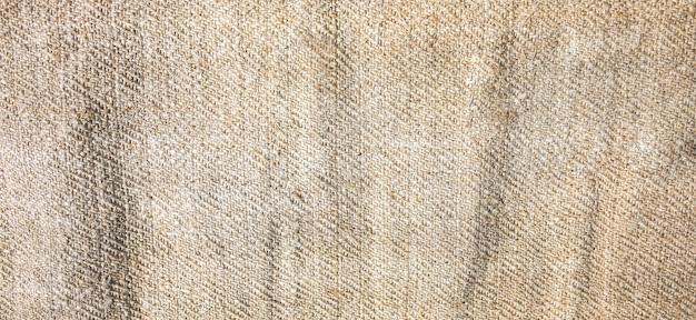Guardanapo de toalha de mesa antigo rústico de linho. textura de fundo vintage natural.