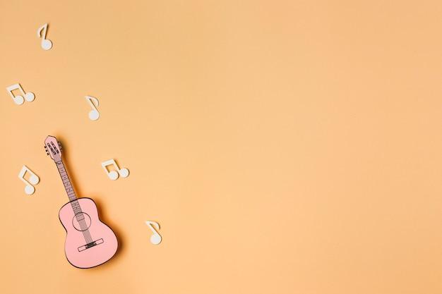 Guitarra rosa com notas musicais brancas