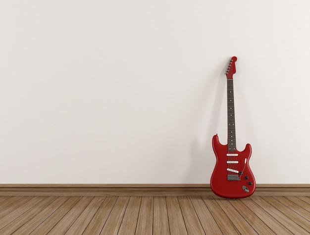 Guitarra vermelha em uma sala vazia
