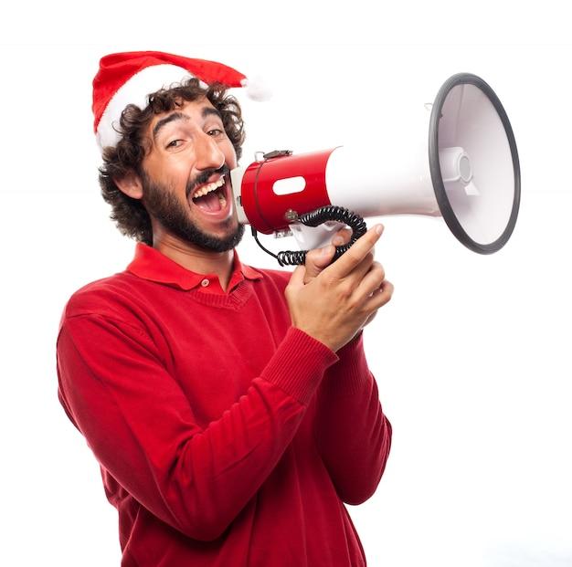 Guy com chapéu do natal que dá ordens
