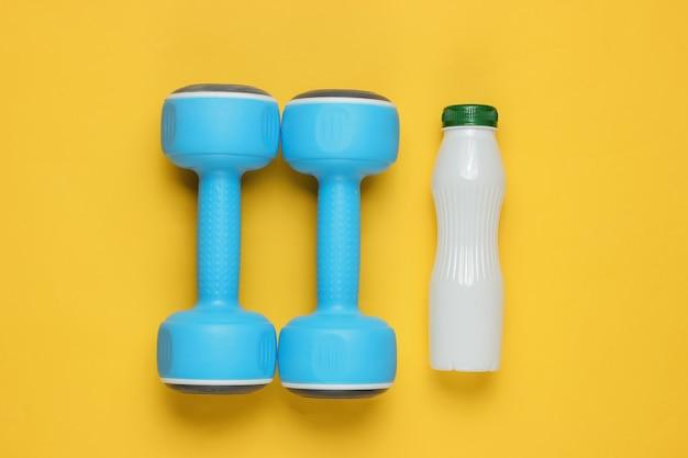 Halteres, garrafa de iogurte em papel amarelo