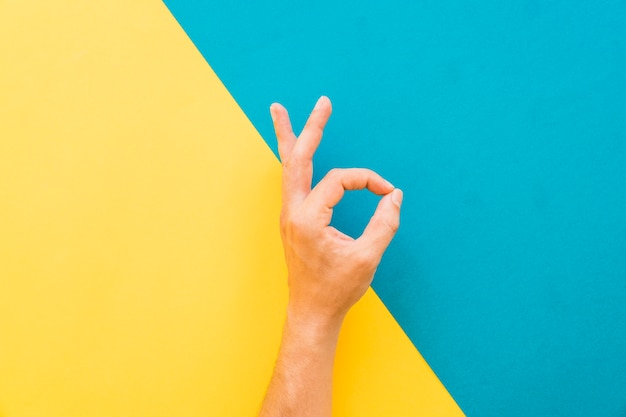 Hand making ok sign
