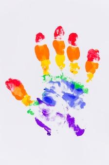 Handprint com as cores da bandeira do orgulho