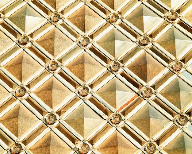 Hd simétrico de fundo de textura de padrão dourado