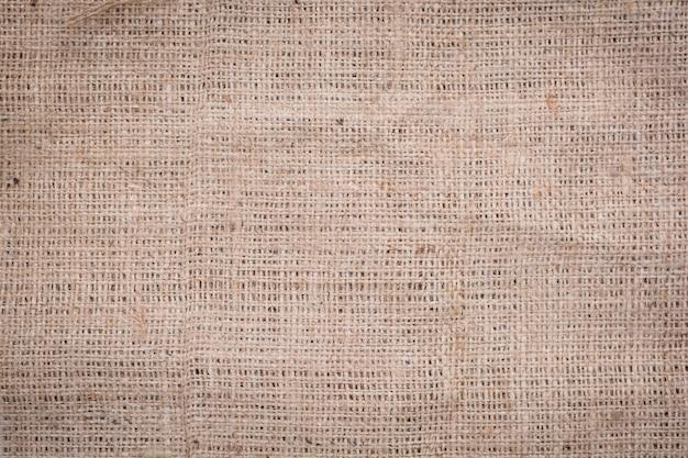 Hessian sackcloth tecido textura de fundo em tom de cor marrom creme bege claro