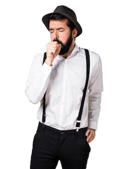 Hipster homem com barba tossindo muito