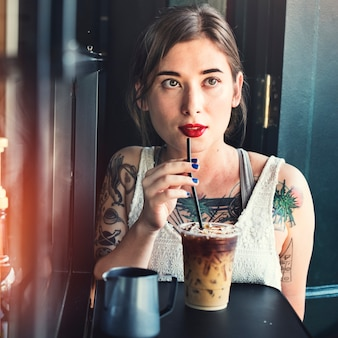 Hipster woman drinking iced coffee concept
