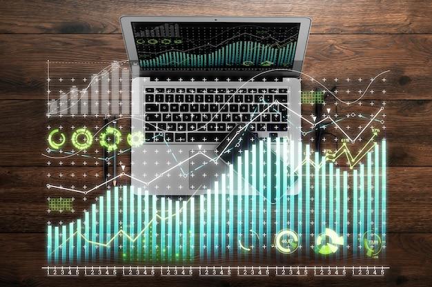 Holograma de gráfico financeiro, gráfico no laptop do escritório