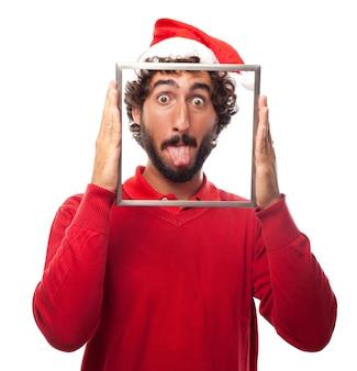 Homem alegre com uma língua quadro mostrando