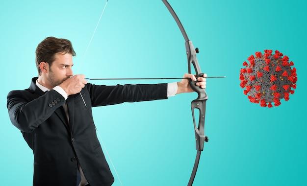 Homem apontando célula de coronavírus com arco e flecha
