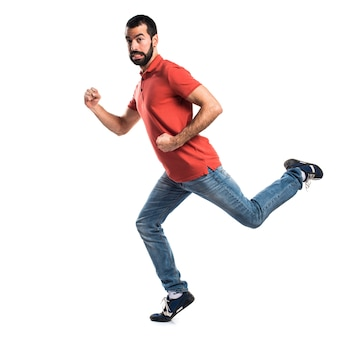 Homem bonito correndo rápido