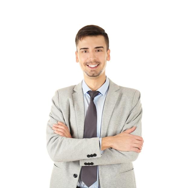 Homem bonito em um terno elegante em fundo branco