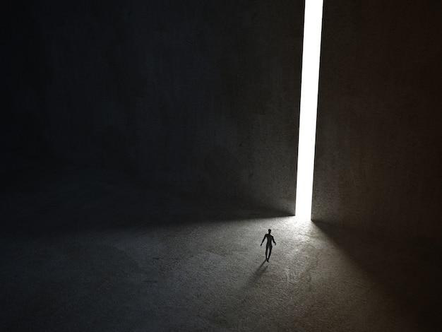 Homem caminhando por uma passagem estreita e iluminada Foto Premium