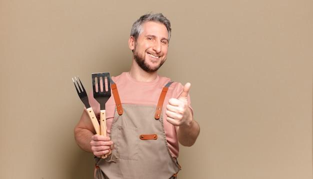 Homem-chef de meia-idade. conceito de churrasco