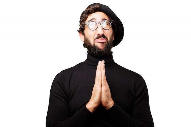Homem com boina orando