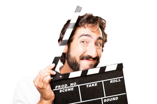 Homem com uma claquete de cinema