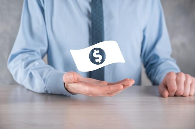 Homem de empresário com ícone de moeda de dinheiro em suas mãos. conceito de dinheiro crescente para finanças e investimento empresarial. usd ou dólar americano na parede de tom escuro.