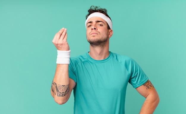 Homem de fitness fazendo capice ou gesto de dinheiro, dizendo para você pagar suas dívidas!
