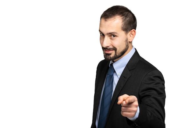 Homem de negócios bonito apontando o dedo para você