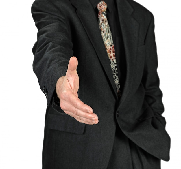 Homem de negócios com a mão aberta pronta para selar um acordo