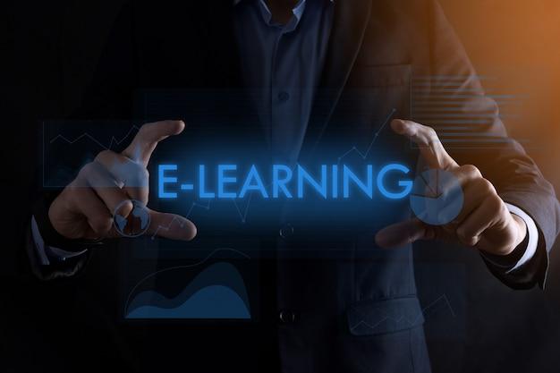 Homem de negócios com as mãos segurando a inscrição e-learning com gráficos diferentes