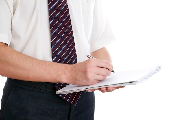 Homem de negócios com caneta e bloco de notas de terno
