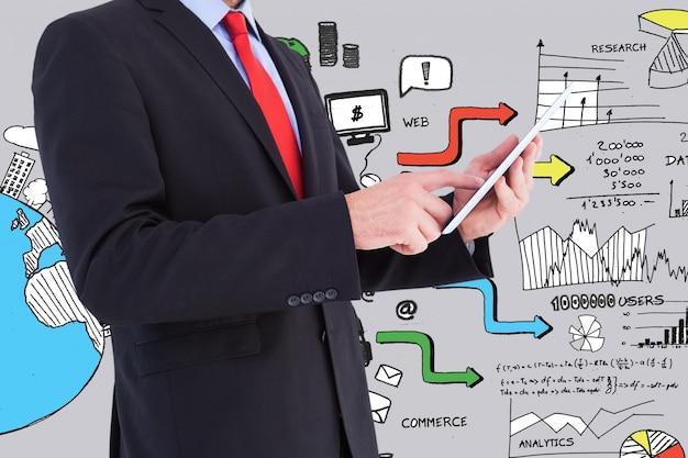 Homem de negócios elegante com um tablet e gráficos de fundo