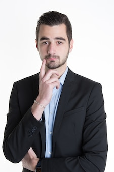 Homem de negócios jovem bonito pensando, isolado sobre a decoração de hanukkah branca