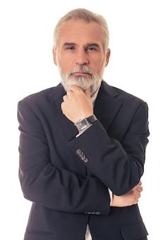 Homem de negócios maduro farpado considerável no terno clássico.