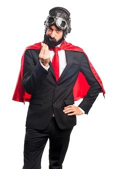Homem de negócios super-herói fazendo um gesto de dinheiro