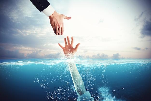 Homem de negócios tende a mão para salvar uma pessoa que está se afogando