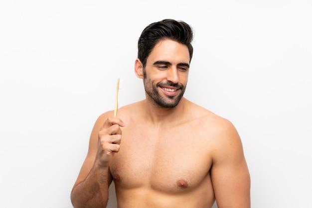 Homem, dentes escovando, sobre, isolado, branca