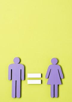 Homem e mulher em pé com sinal de igual entre eles copiam o espaço
